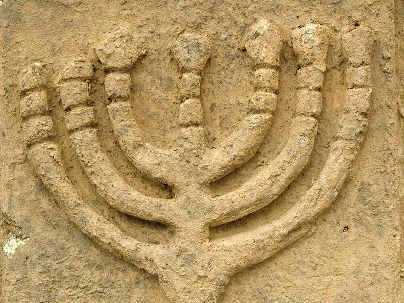 Ancient menorah carving