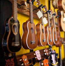 Wall of assorted ukuleles